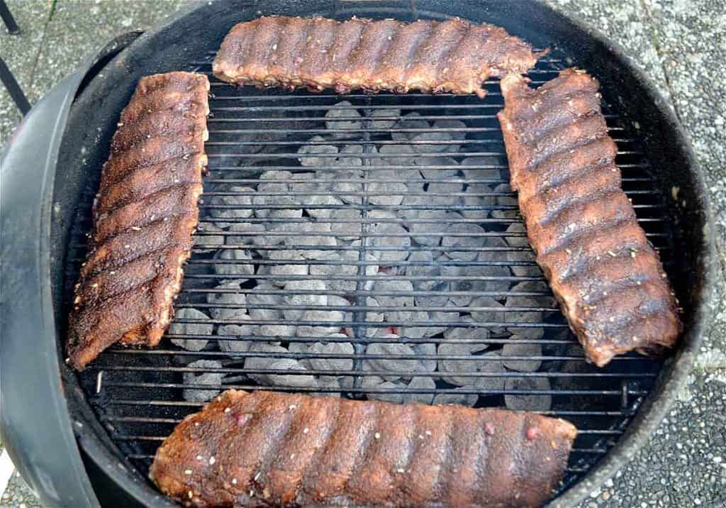 Grilled ribs on a charcoal grill.