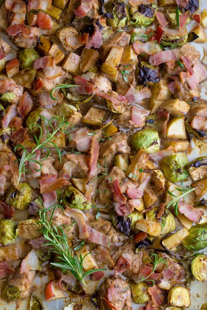 Sheet pan with chicken, bacon, apples, and Brussels sprouts.