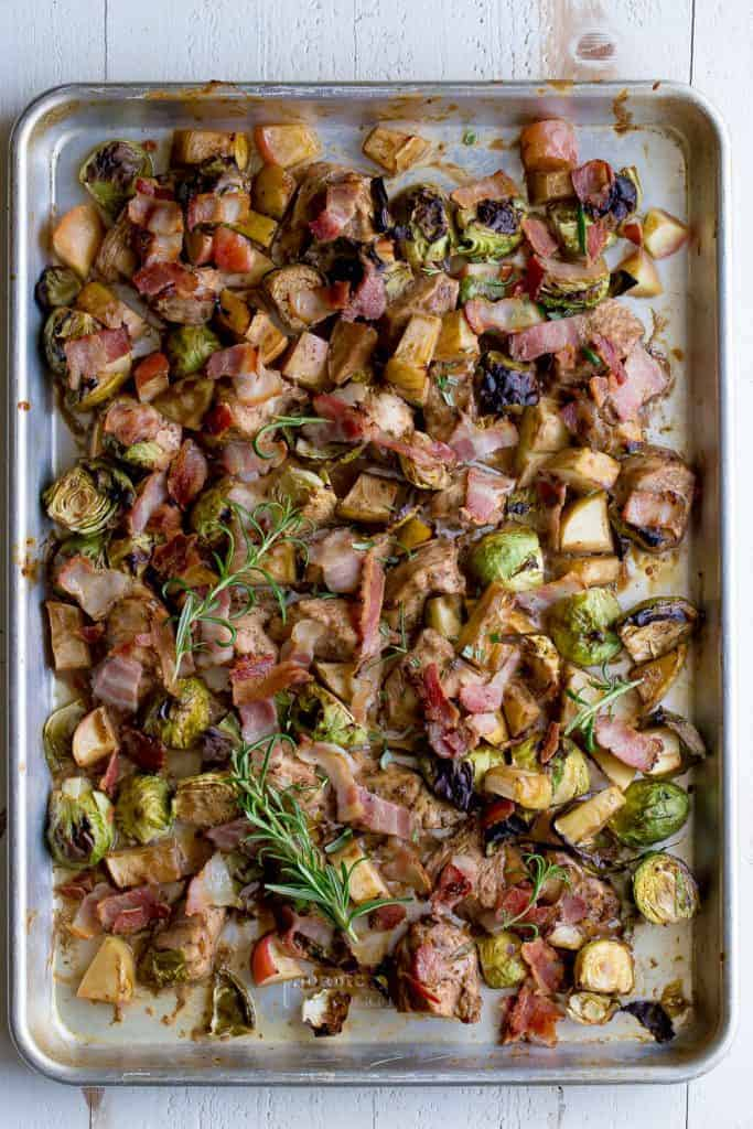 Sheet pan chicken with bacon, Brussels sprouts, apples, and rosemary.