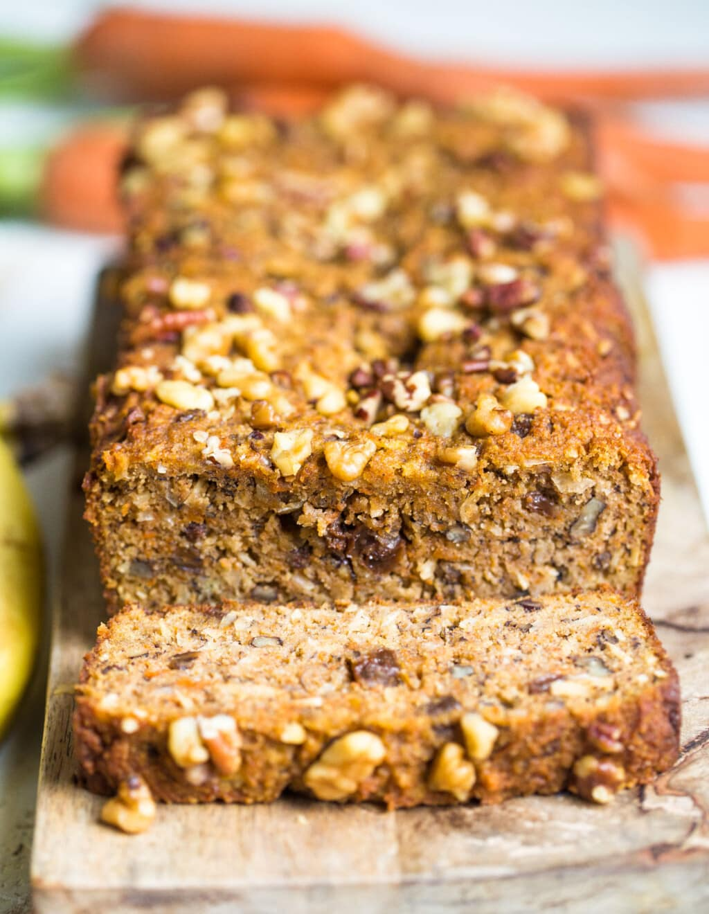 Loaf of carrot cake banana bread with a slice cut off the end