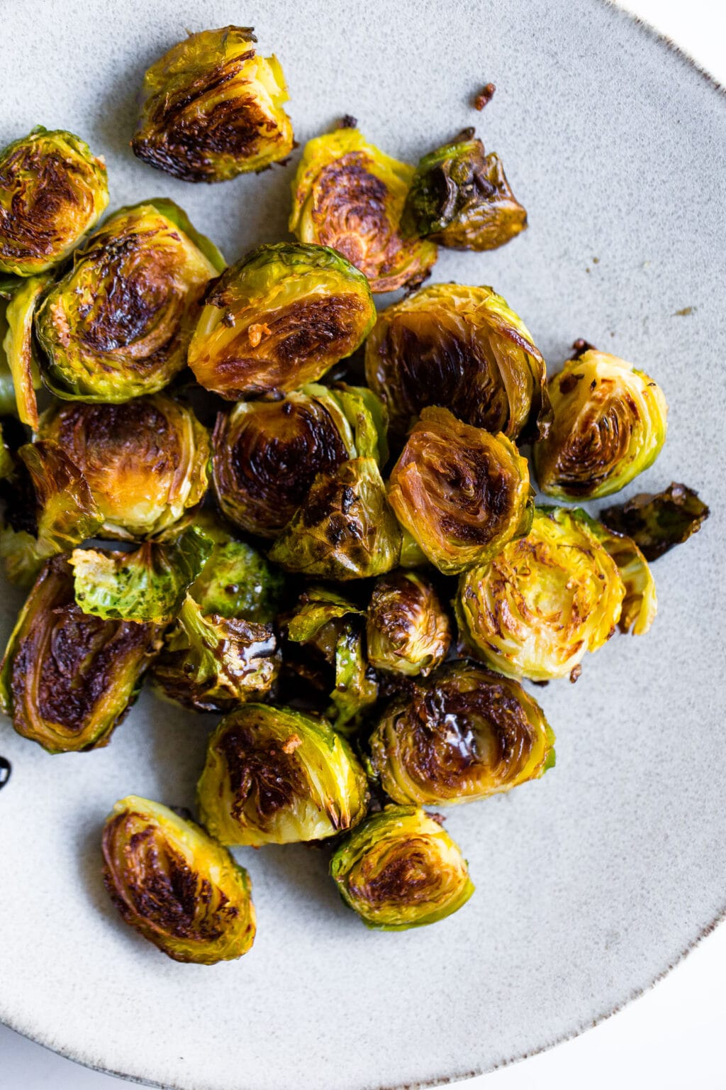 Plate of roasted balsamic brussels sprouts.