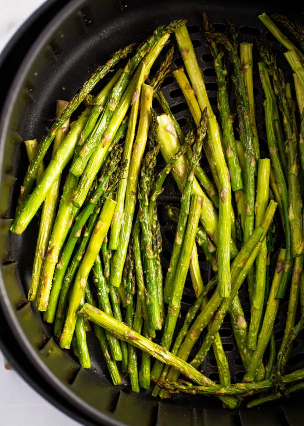cooked asparagus in an air fryer