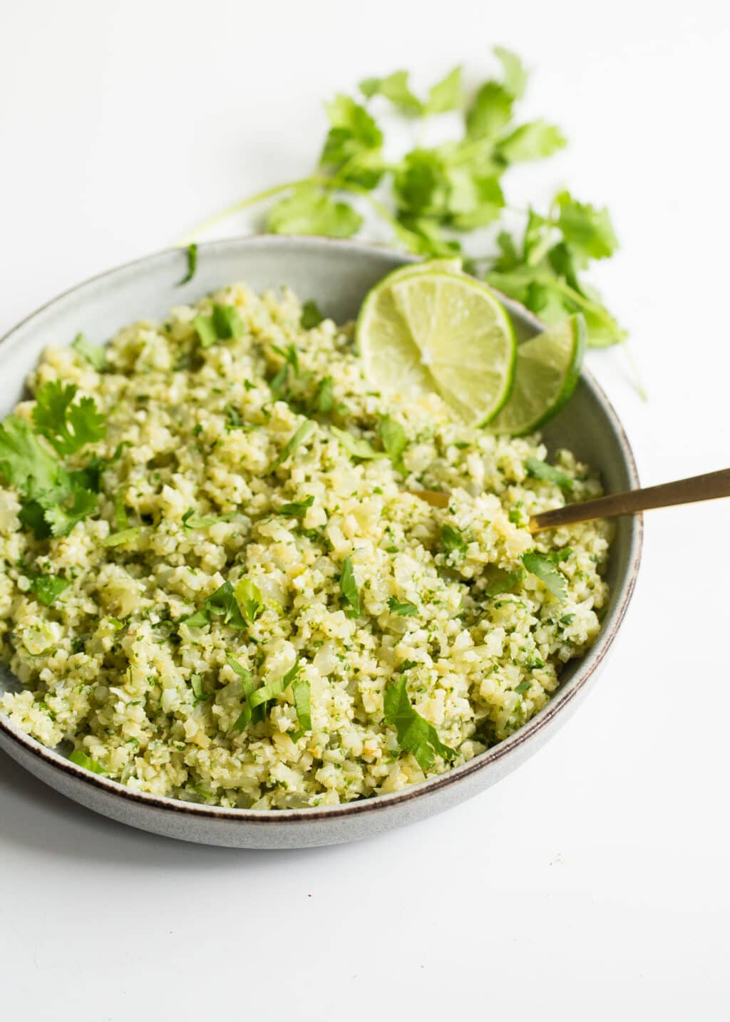 cauliflower rice with lime and cilantro in a bowl.