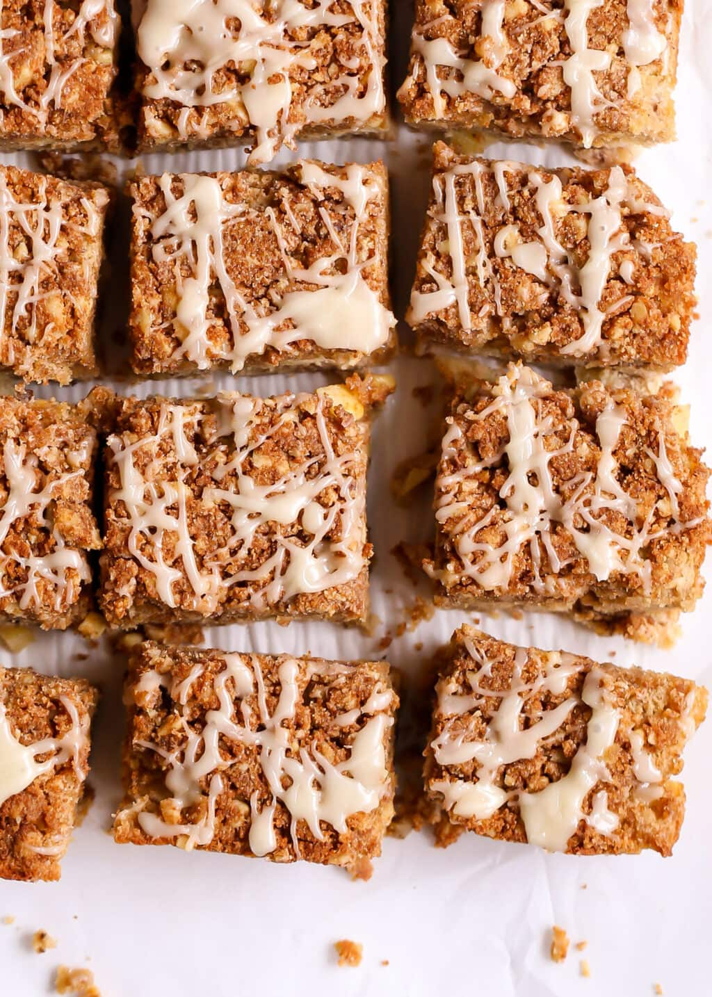 Apple Coffee Cake slices with maple drizzle cut into squares.
