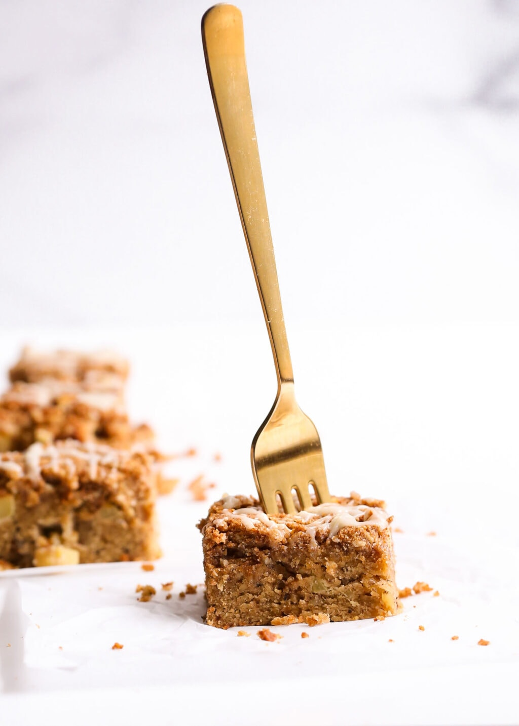 Apple Coffee Cake with a gold fork sticking out.