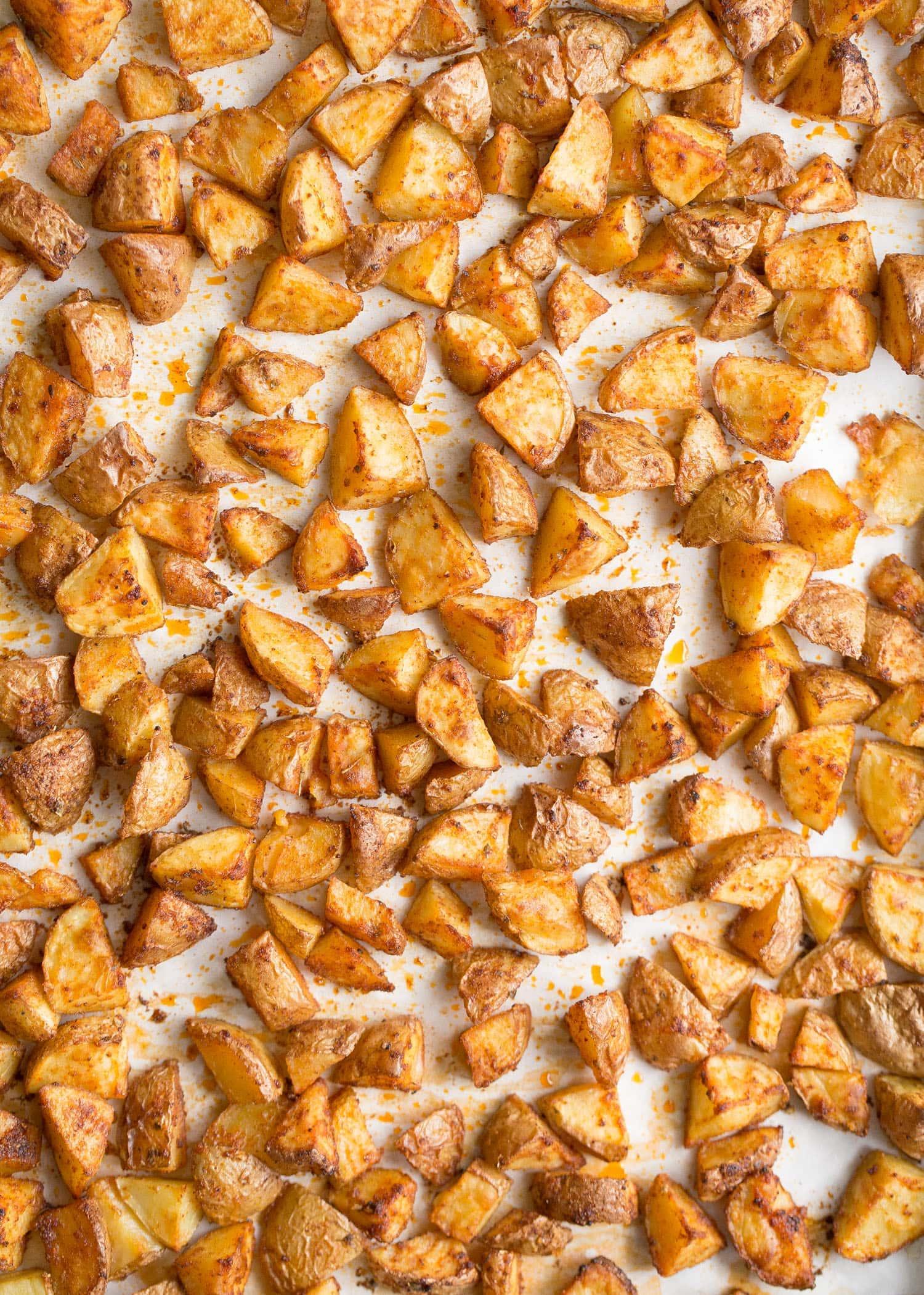 Crispy seasoned potatoes on a sheet pan